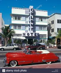 vintage car outside the art deco colony hotel ocean drive south