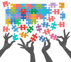 female hands work together to connect jigsaw puzzle pieces royalty