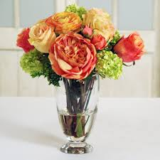 ranunculus bouquet roses ranunculus bouquet in glass vase skaff floral creations