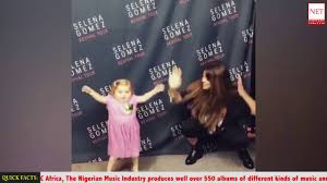 watch selena gomez dance with this cute kid with a rare life