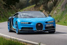 yellow and silver bugatti black magic what really enables the bugatti chiron to hit 260