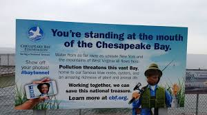 the virginia restaurant you must visit before it closes sign with chesapeake bay facts outside the chesapeake bay bridge tunnel restaurant