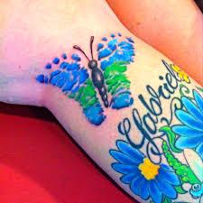 feather on foot tattoo baby footprint butterfly tattoo tattoo ideas pinterest baby