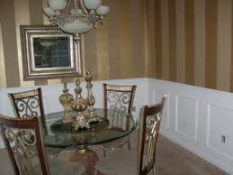 vertical metallic gold stripes in dining room
