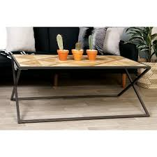 cross leg coffee table light brown geometric patterned coffee table with black cross legs