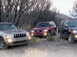 difference between jeep grand laredo and limited 2005 gmc envoy slt vs 2004 ford explorer xlt vs 2005 jeep grand