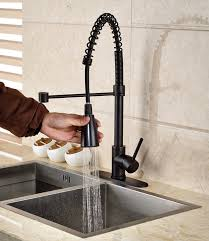 rubbed bronze kitchen sink faucet tindouf rubbed bronze kitchen sink faucet with pull sprayer