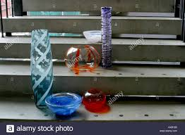 a collection of designer vases are standing on the steps of the