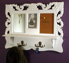 shabby chic antique white wooden wall shelf with coat hooks photo