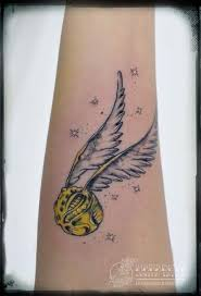 harry potter tattoos 28 pics the snitch color is great ink