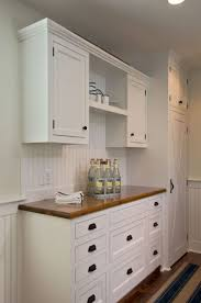 kitchen custom white cabinet with reclaimed pine countertop with custom white cabinet with reclaimed pine countertop with beadboard backsplash also warwick fixed pull in rust and