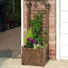 greenhurst trellis planter with solar lanterns garden street