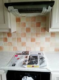 painted tile backsplash cover those ugly tiles make and diy painted kitchen tile backsplash cheap and easy update for dated makedoanddiy