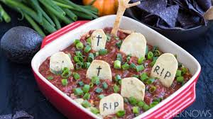this graveyard taco dip is your new fave halloween snack
