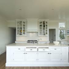 kitchen with large white subway tiles design ideas