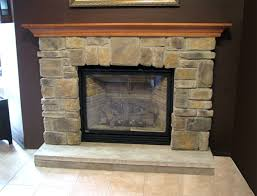 interior stacked stones fireplace veneeer displaying with stone