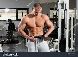 young bodybuilder girding on his bodybuilding stock photo 69257578