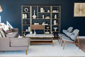mid century modern living room ideas blue living room with wood and brass shelving unit transitional