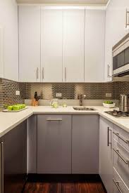 white kitchen cabinets with stainless steel backsplash 18 stylish kitchens with stainless steel backsplashes