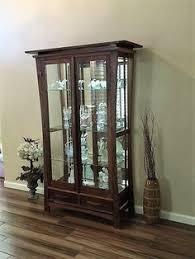 Ideas Design For Lighted Curio Cabinet Lynwood Corner Curio Cabinet In Windsor Cherry Howard Miller