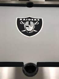 tiger woods shows off new raiders pool table and billiard balls