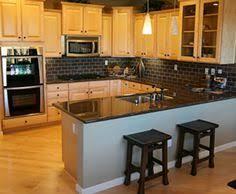 Backsplash Ideas With Dark Granite Countertop by Kitchen With Undercounter Microwave Drawer Granite Countertop