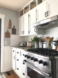 is it worth painting your kitchen cabinets how to paint kitchen cabinets and a 5 year update