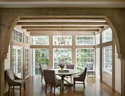 elegant dining room surrounded by windows transitional dining room