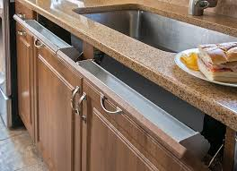 kitchen sink cabinet sponge holder the pros cons of kitchen tip out trays