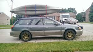 subaru outback wheels gold wheels kayaks rally lights and mudflaps all the subaru