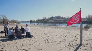 Flags At Half Mast Michigan City Of Holland Warns Against Swimming On Red Flag Days At State
