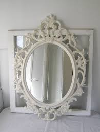 a beautiful large baroque ornate shabby chic antique white mirror