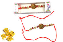 send rakhi within usa golden swastik rakhi with sendrakhis