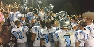 4 lansing catholic football players benched for planning to kneel