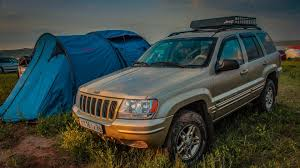 2000 gold jeep grand cherokee jeep grand cherokee v8 gold drive2