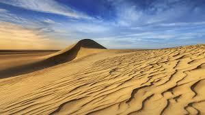 sunset over the western part of the sahara desert in egypt