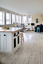 white washed wood flooring family room eclectic with none