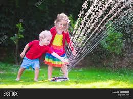 child playing garden sprinkler image u0026 photo bigstock