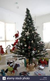 christmas tree with decorations and presents in daytime living