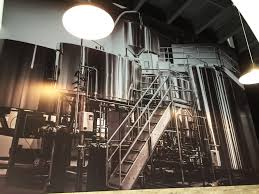 wall heroes saves the day with rustic graphics big picture northwestern brewery gains presence through wall mural