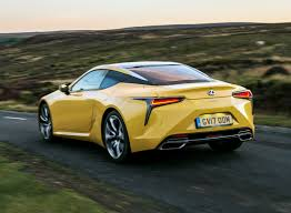 lexus yellow sports car lexus lc coupe driving and performance parkers