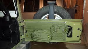 jeep tailgate storage mod 3 extra storage for emergency kit smittybilt tailgate cover