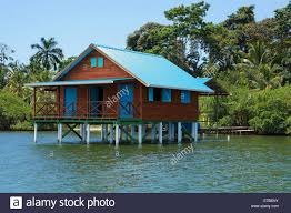 bungalow on stilts over water of the caribbean sea bocas del toro