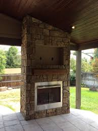 unfinished outdoor gas fireplace with tv above that placing in