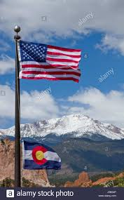 Bronco Flag American And Colorado Flag Waving In The Wind With Pikes Peak And