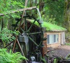 off grid living ideas small log cabin with water wheel off the grid living 오두막