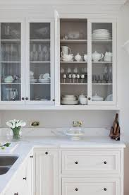 white kitchen cabinets with glass cup pulls how to mix and match your kitchen cabinet hardware