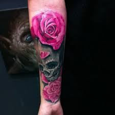 colors skull with pink roses forearm skull