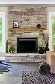 simply cover an existing fireplace with real thin stone natural nice stone but maybe a little more grey tones