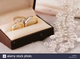 wedding rings in box gold wedding rings with engagement ring inside box stock photo